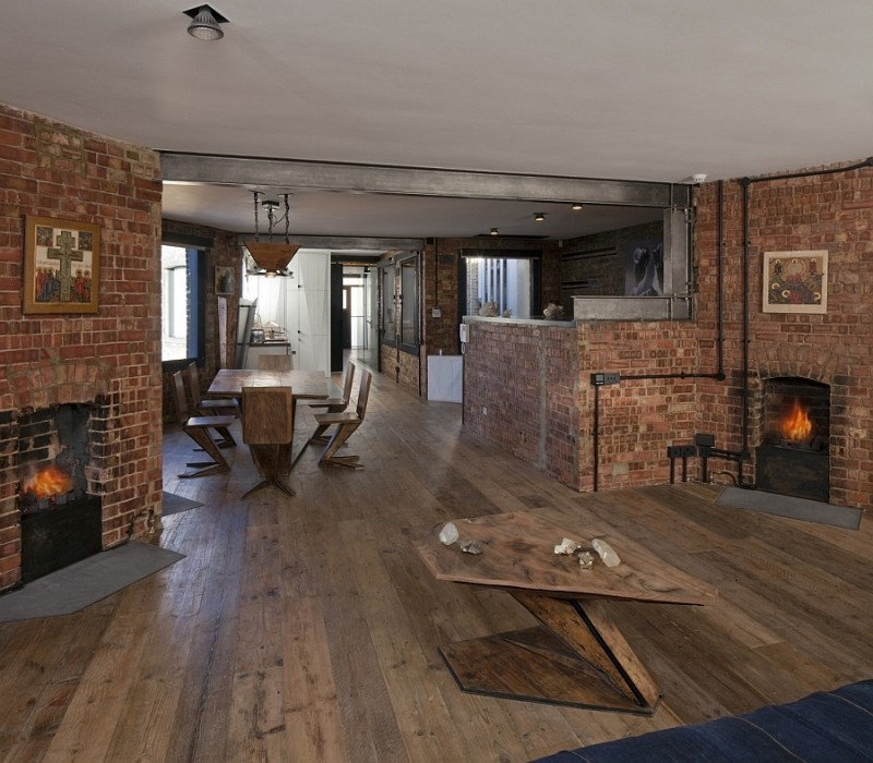 traditional-fireplaces-and-the-brick-walls-give-the-home-a-classic-english-look-800x700